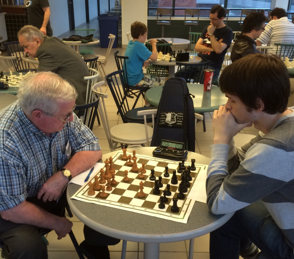 Brian Oliver (white) and Anthony Leonard debate the Semi-Slav.
